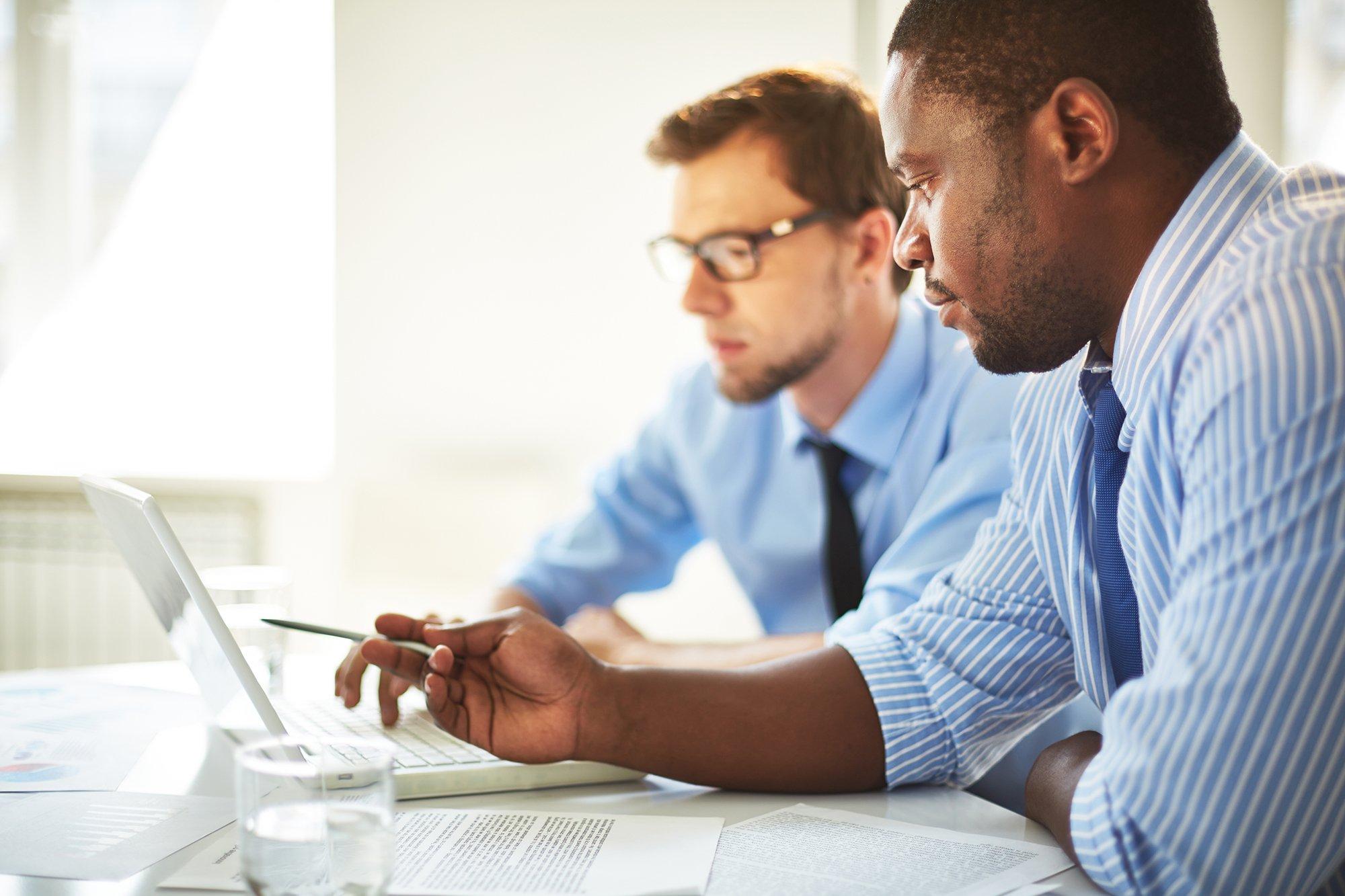 men-working-on-computer